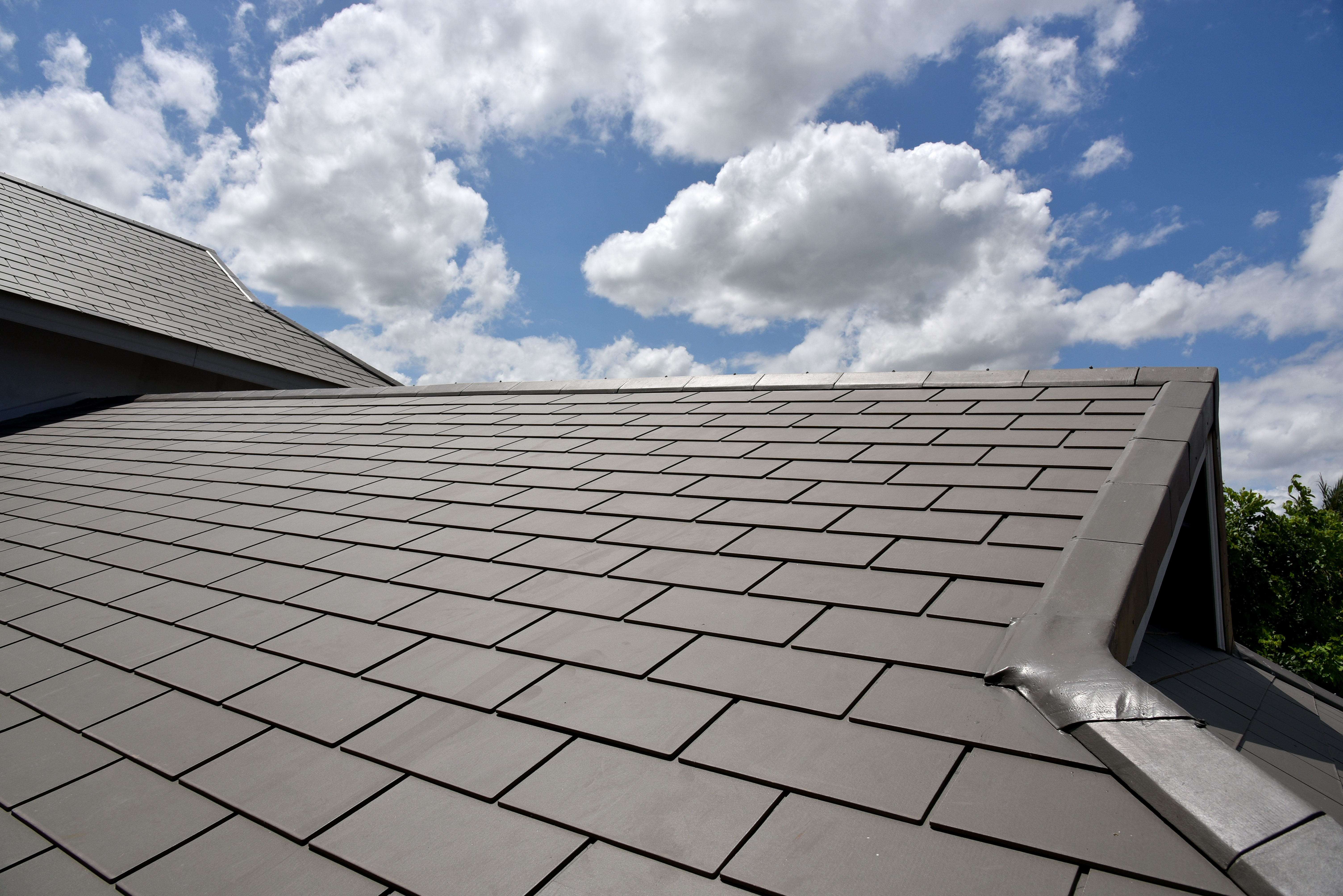 benefits of replacing old roof tiles